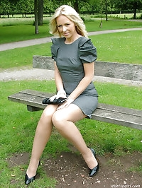 Sultry blonde with great smile posing outdoors in her high..