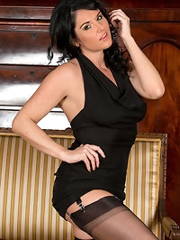 UK mom Leah looks stunning in a sexy black evening dress,..