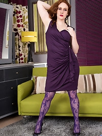 Looking fine in a purple evening gown and matching sheer..