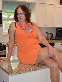American housewife playing in the kitchen