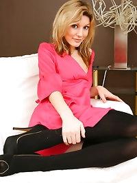 Nicole looks amazing in pink minidress.