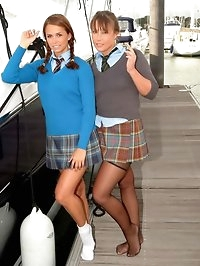 Two sexy girls in college uniforms with stockings