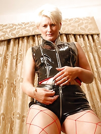 Fetish MILF in leather shows off her mature body for the..